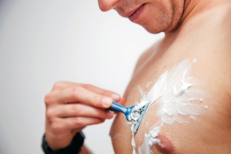 young-man-shaving-chest.jpg
