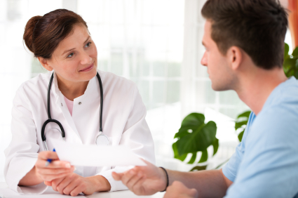 female-doctor-talking-to-male-patient.jpg