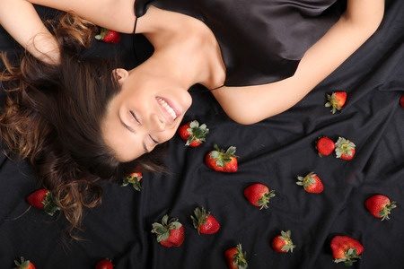 woman-daydreaming-in-bed-of-strawberries.jpg