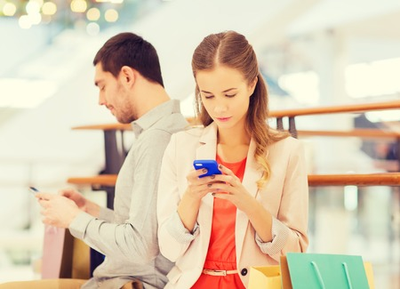 couple-using-phones-in-mall.jpg