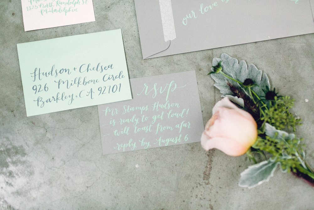 #hudsonloveschelsea // invitation + calligraphy by hello, bird. featuring watercolor portrait by pennys & stamps // photo courtesy of danfredo photography // florals by kate farley design // styled by confetti & co.