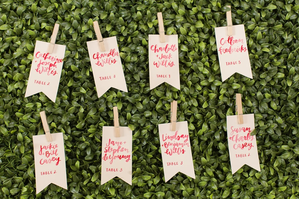 hello, bird. brush calligraphy on hanging escort card tags // photo by ara joetta photography on 35mm film // featured on midwest bride