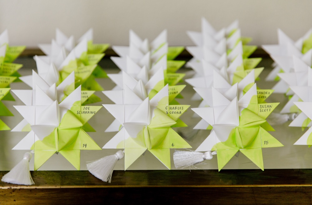 hello, bird. gray ink calligraphy on chartreuse wash moravian stars escort cards // photo courtesy of Emily Wren Photography