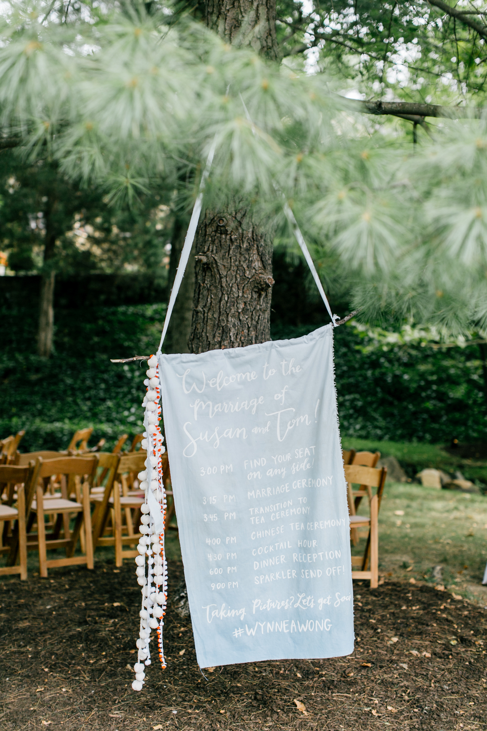 hand-dyed fabric ceremony program by hello, bird. // pom-pom tassels handcrafted by the bride + groom // photo by emily wren photography