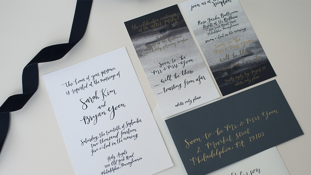 Sarah + Bryan's invitation suite by hello, bird. // black and white oversized calligraphy invitation; ombre rsvp card; gold ink on charcoal