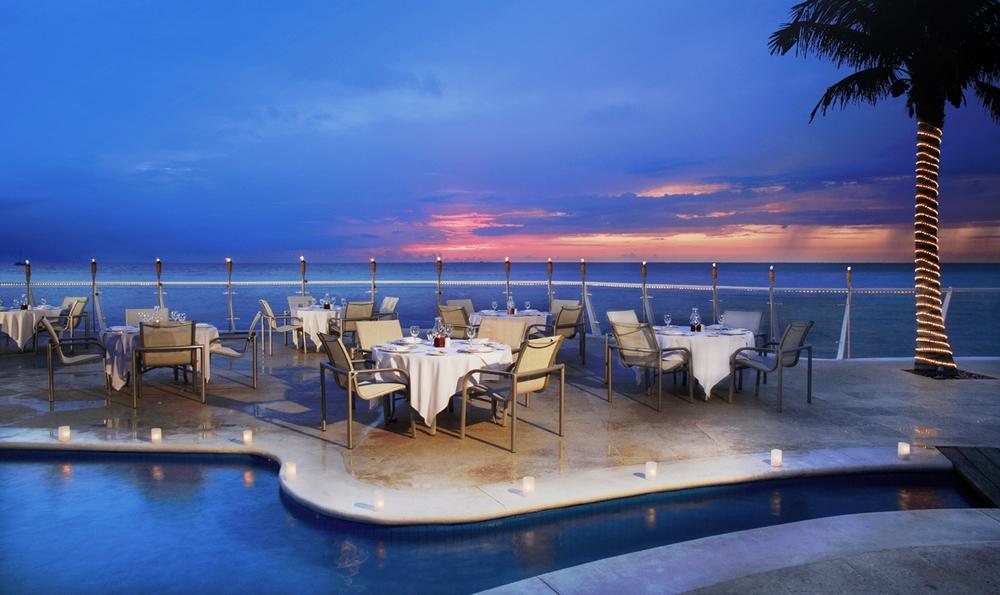 lp_157_Cozumel-Palace-Flamingos-Pool-Dining.jpg
