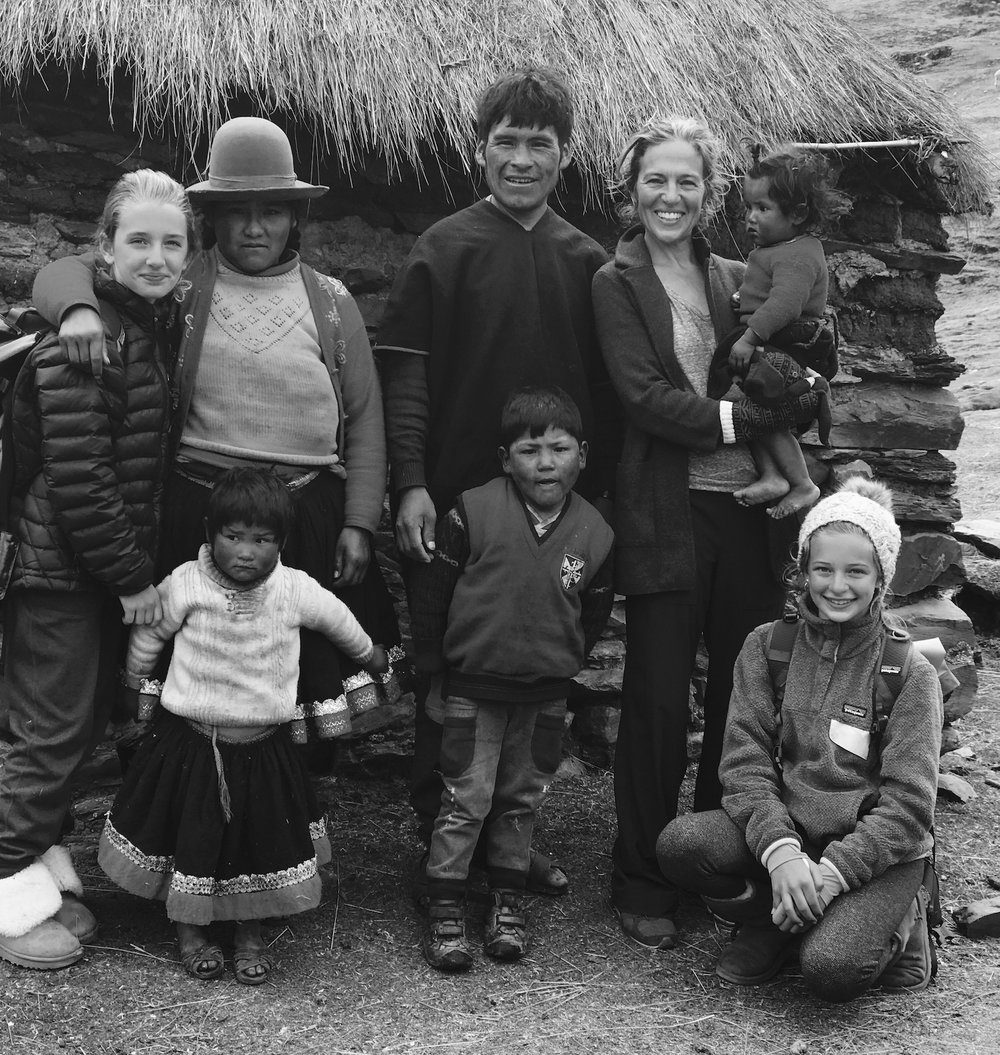 Katie Hebson and daughters, Fifi and O'Neill, pictured here with their hosts, the Machacca family, during Snapshot Project Qochamoqo, Peru 2017.