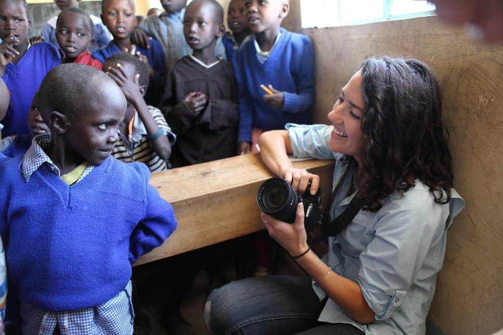 Kelly Johnson on location for humanitarian work with a remote village school in Kenya.