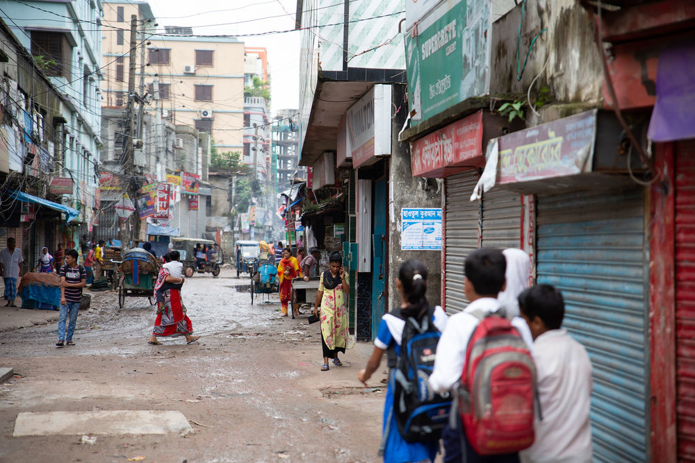 100cameras Snapshot Dhaka students pass through bustling streets on their way to school, Nuru Chala neighborhood.