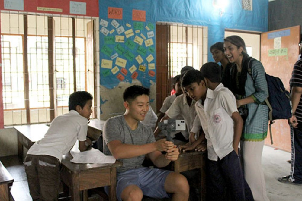 Andrew shows students his documentary video in a Nuru Chala Primary School Classroom.