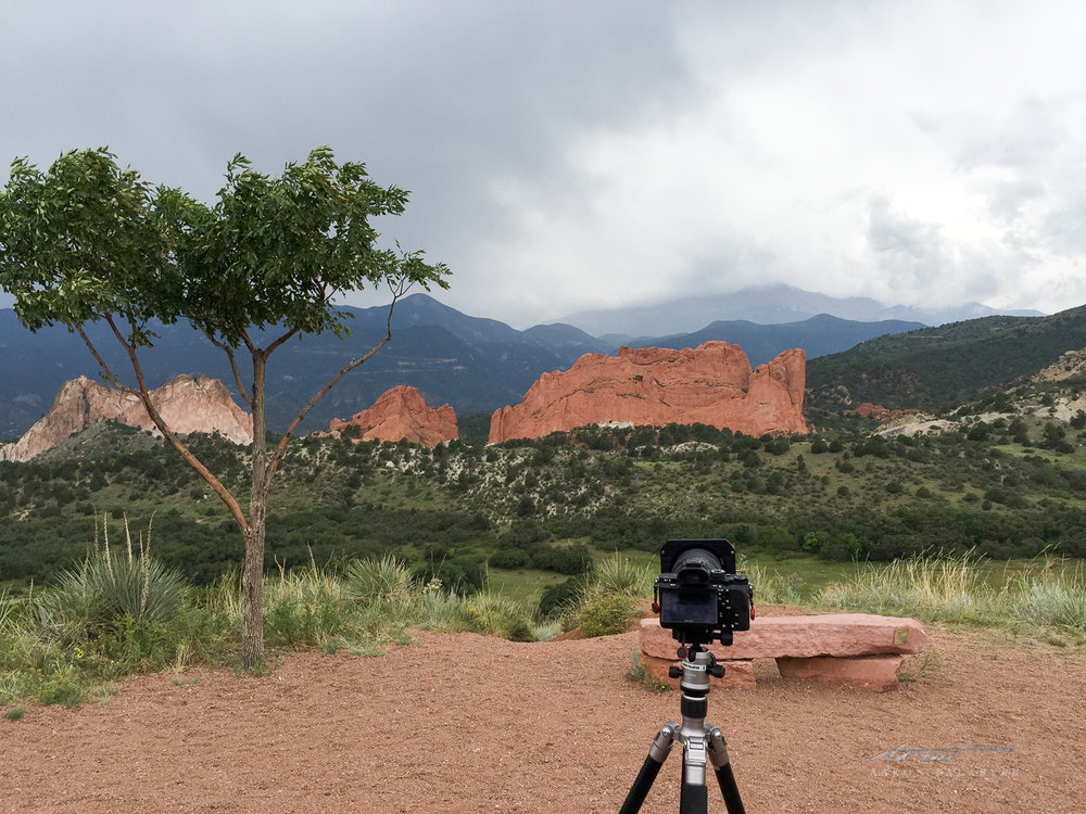 Setting up a time-lapse as a storm comes in over Pike's Peak