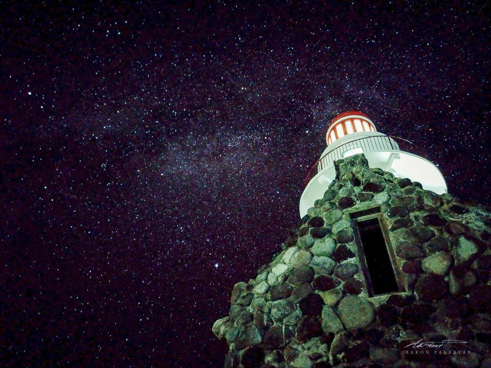 Naidi Lighthouse and the dimmer section of the Milky Way.