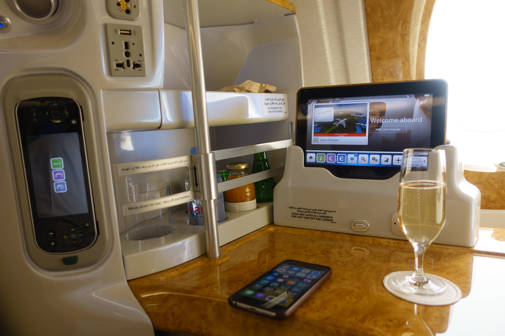 Champagne and in-seat mini-bar with handheld and tablet IFE controllers