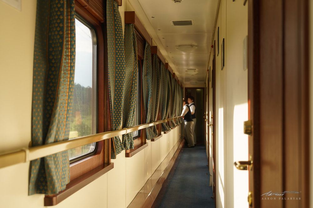 The hallway outside the Deluxe Gold cabins and our carriage's cabin attendants enjoying the scenery