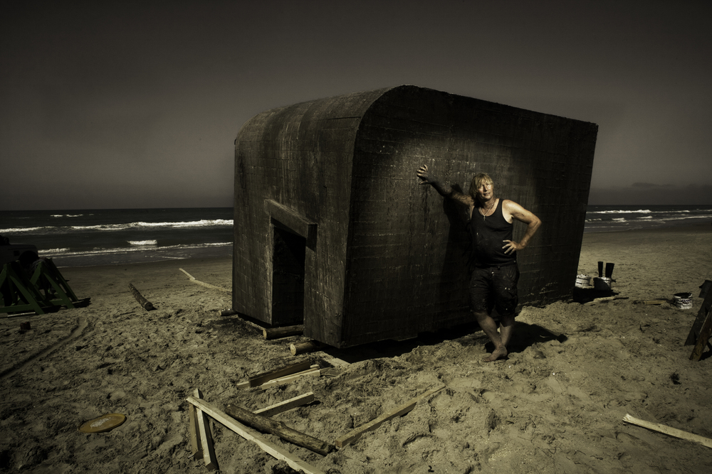 Artist Erik Peitersen, with his amazing and surreal floating bunker, which was dragged out to sea where it bobbed around with the motion of the water