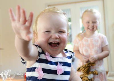 Baby Abi and young Mia having fun infront of the camera for family portrait