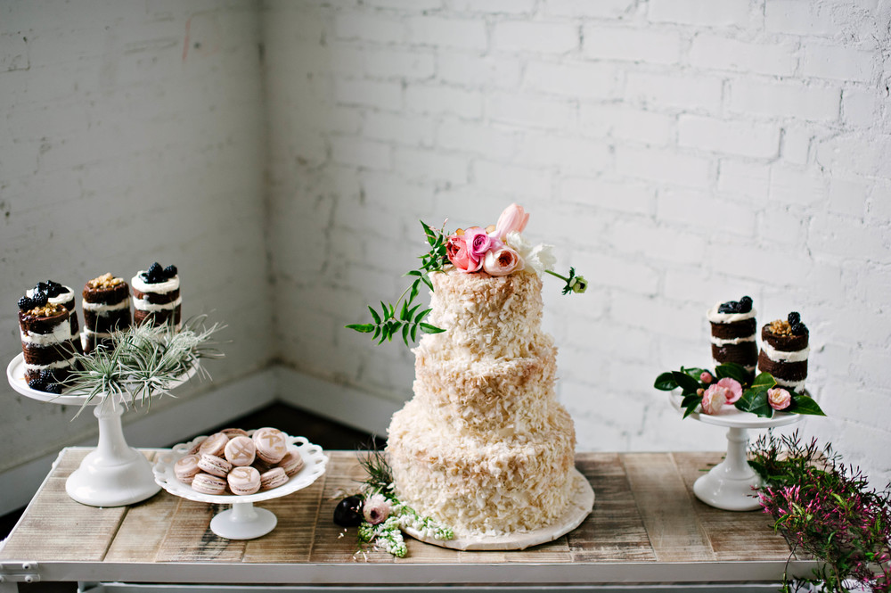 custom-wedding-cake-coconut-texture-mini-cakes-fresh-berries.jpg