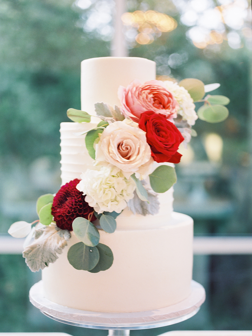 custom-wedding-cake-white-texture-cascading-flowers-sugarbeesweets.jpg