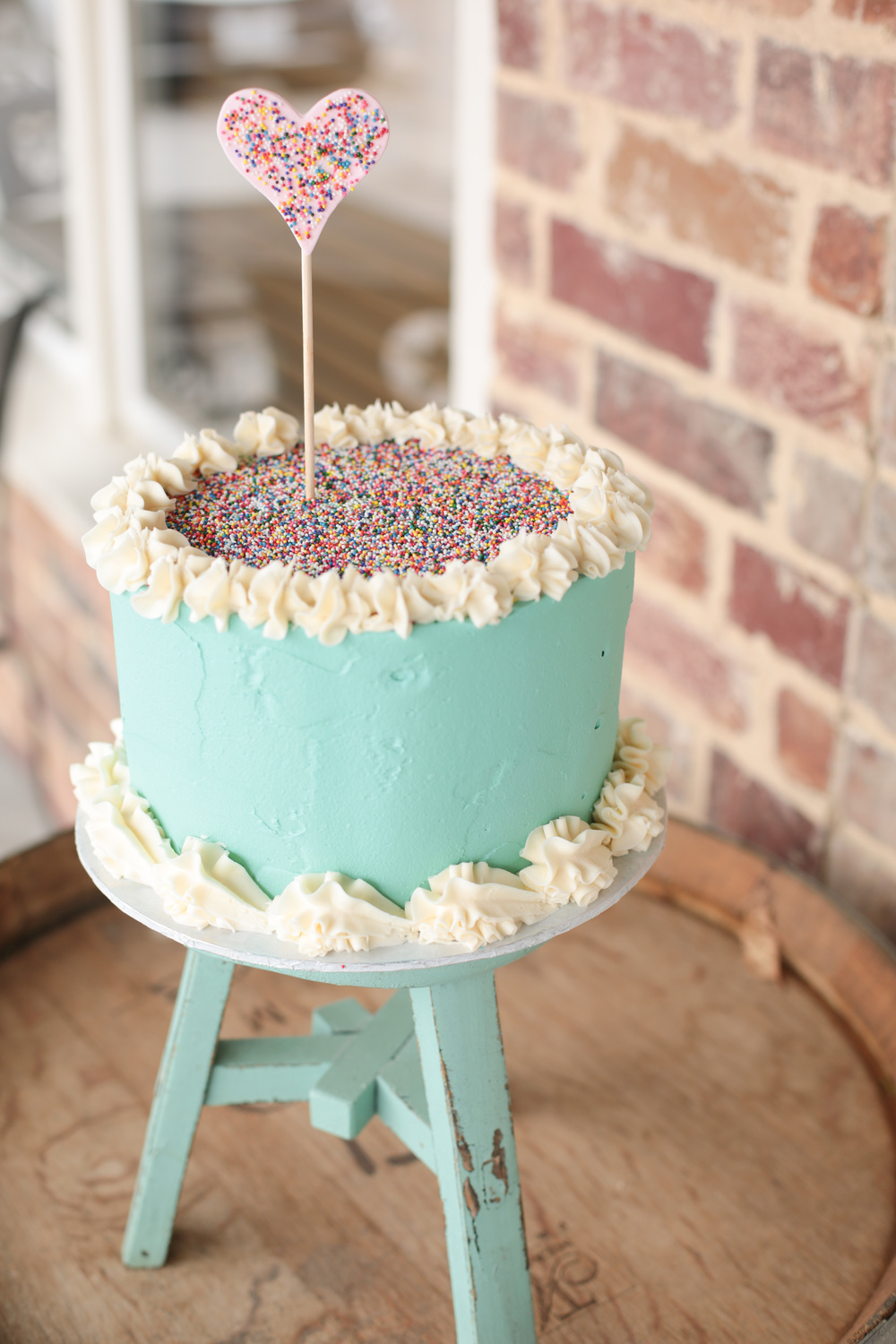 sugarbeesweets-signature-cake-unfinished-buttercream-sprinkles.jpg