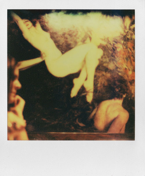 In Full Swing, 2011, from Four Sisters, Polaroid SX-70 print, mounted on Impossible Project White Leather SX-70 Polaroid Camera Case, white kid leather gloves (made in France, 1970s). Dimensions: 8.75 in long, 4.75 in. wide, and 1.5 in high.