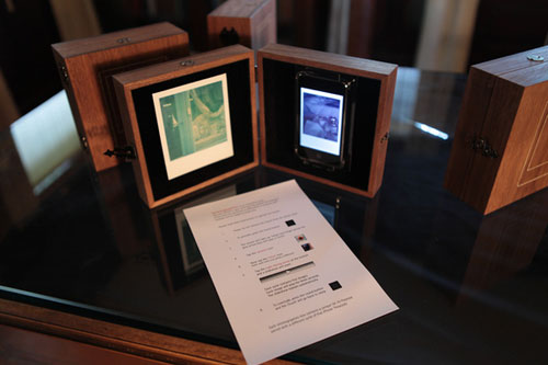 "View of the installation  Intimographies  showing the instruction for operating the slide show on the iTouch device. In the exhibition ""New Media at the Charles Allis,"" Charles Allis Art Museum, Milwaukee, Wisconsin, June 1 to September 15, 2010.                          Normal.dotm     0     0     1     35     201     GVSU     1     1     246     12.0                          0     false             18 pt     18 pt     0     0         false     false     false                                                     /* Style Definitions */ table.MsoNormalTable 	{mso-style-name:""Table Normal""; 	mso-tstyle-rowband-size:0; 	mso-tstyle-colband-size:0; 	mso-style-noshow:yes; 	mso-style-parent:""""; 	mso-padding-alt:0in 5.4pt 0in 5.4pt; 	mso-para-margin:0in; 	mso-para-margin-bottom:.0001pt; 	mso-pagination:widow-orphan; 	font-size:12.0pt; 	font-family:""Times New Roman""; 	mso-ascii-font-family:Cambria; 	mso-ascii-theme-font:minor-latin; 	mso-fareast-font-family:""Times New Roman""; 	mso-fareast-theme-font:minor-fareast; 	mso-hansi-font-family:Cambria; 	mso-hansi-theme-font:minor-latin;}"