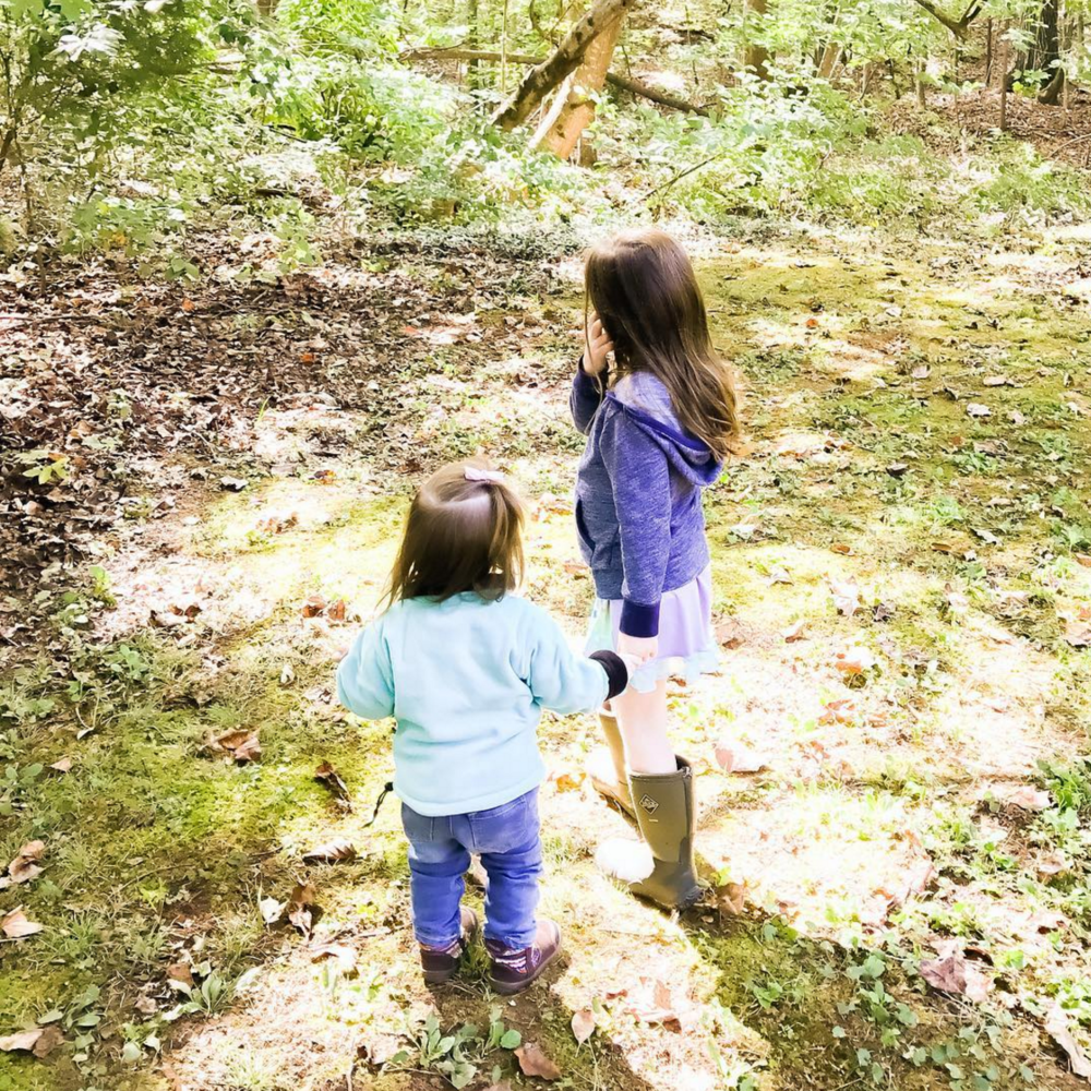 young-girls-walking-in-woods.png