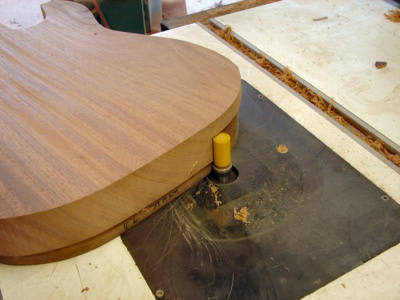 Then waddle over to the router table and rout. One side of the edge only at this time.
