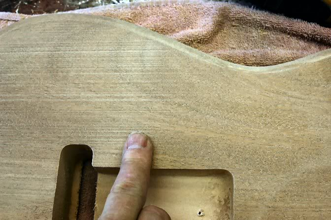 "Now start sanding. I usually go at it with 220, then finish with 320. But watch closely, you want to be sure to remove any ""machine"" marks such as the panel sander's footprints."