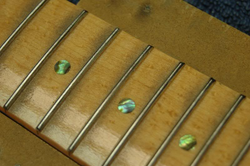 This is what you are looking for. If your neck has the last several frets falling away, that is lower than the rest of the fingerboard, take your fret leveling tool, press down on and over those last few frets from about the 17th on, and level those. This will create a natural incline up to the 16th and lower.