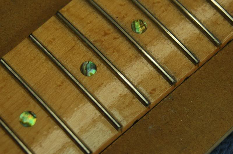 Continue on each fret until the scratches from the fret leveling tool are ALMOST gone. Just a faint hint should remain. Do all the frets the same way. They should all look like this.