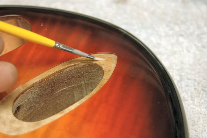 This gives it a fighting chance if anything wet hits the guitar, If left open, the water could soak into the grain, and cause the underlying wood to swell. Not a good thing.