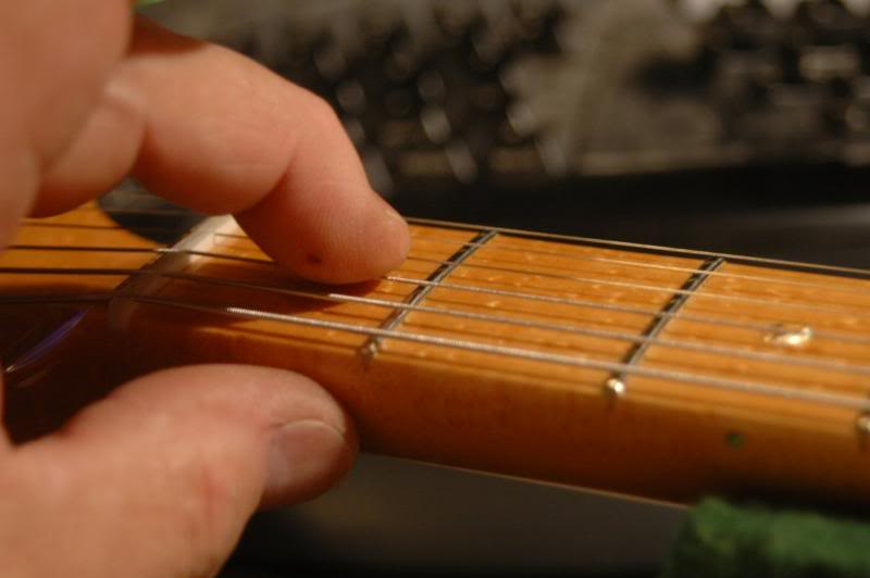 Since I may have raised several strings, I will recheck the height at the first fret and re cut the slots as necessary. Remember the correct height at the first fret is the same as the height at the second fret when the string is fretted at the first.