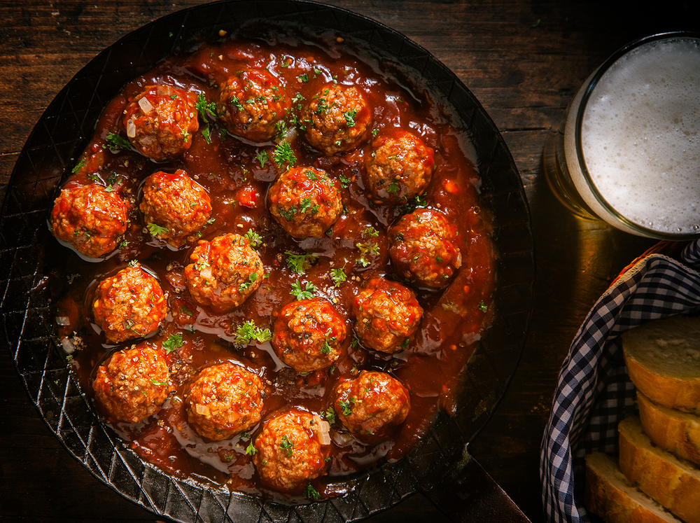 Nonna's classic spicy meatball recipe is a crowd pleaser. Plump, juicy and so tender a spoon can cut through it.