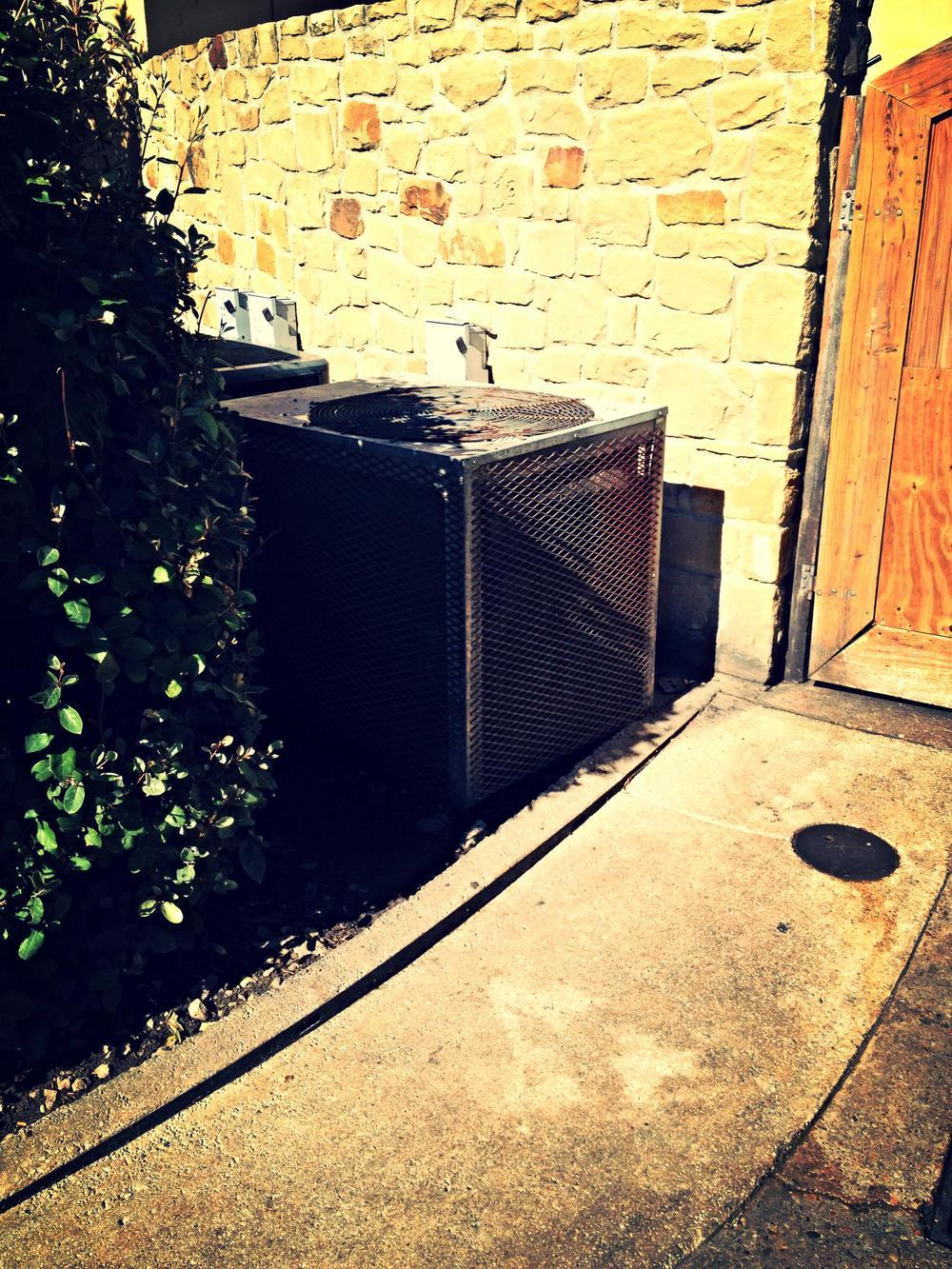 HVAC unit hidden outside a Texas restaurant