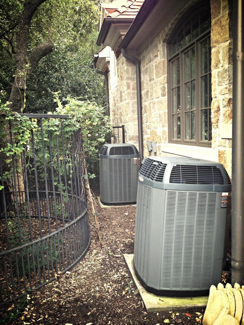 XL19i trane condensers hidden on custom home