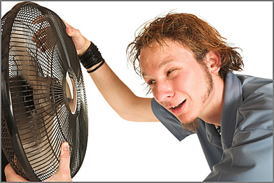 sweaty guy with fan