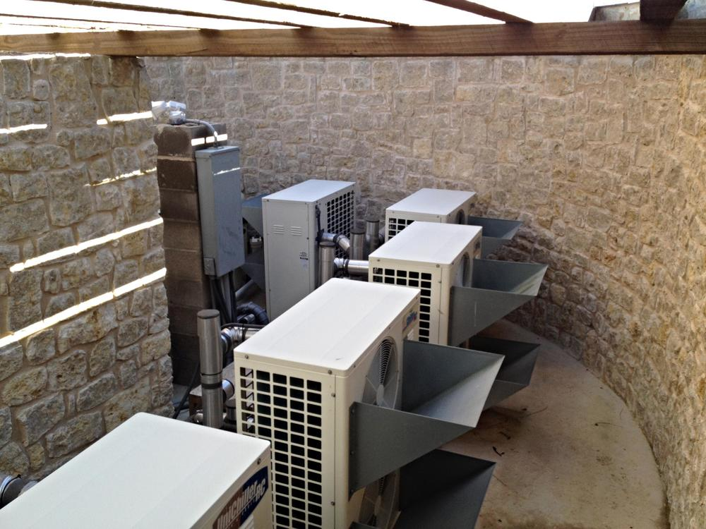 Fenced off air conditioning units