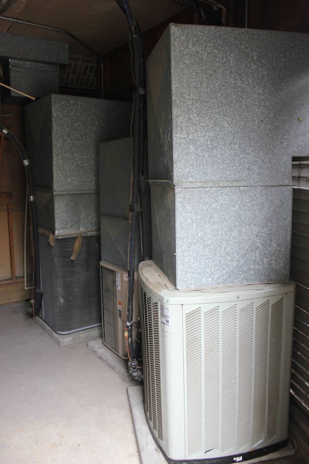 ac condenser units hidden with hood venting