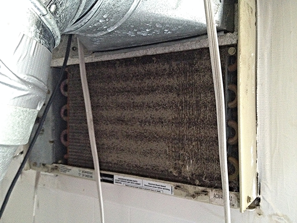 clogged and malfunctioned window unit ac