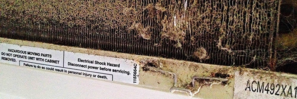 clogged window unit air conditioner warning label