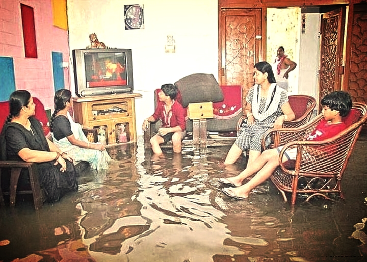 flooded house family in living room watching tv