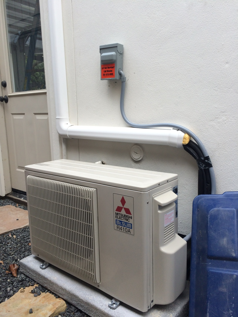 Mitsubishi ducted mini split for Ac condenser pad installation