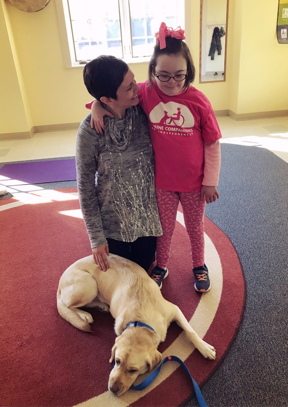 GIta, Molly and service dog Leah relax after a yoga class.