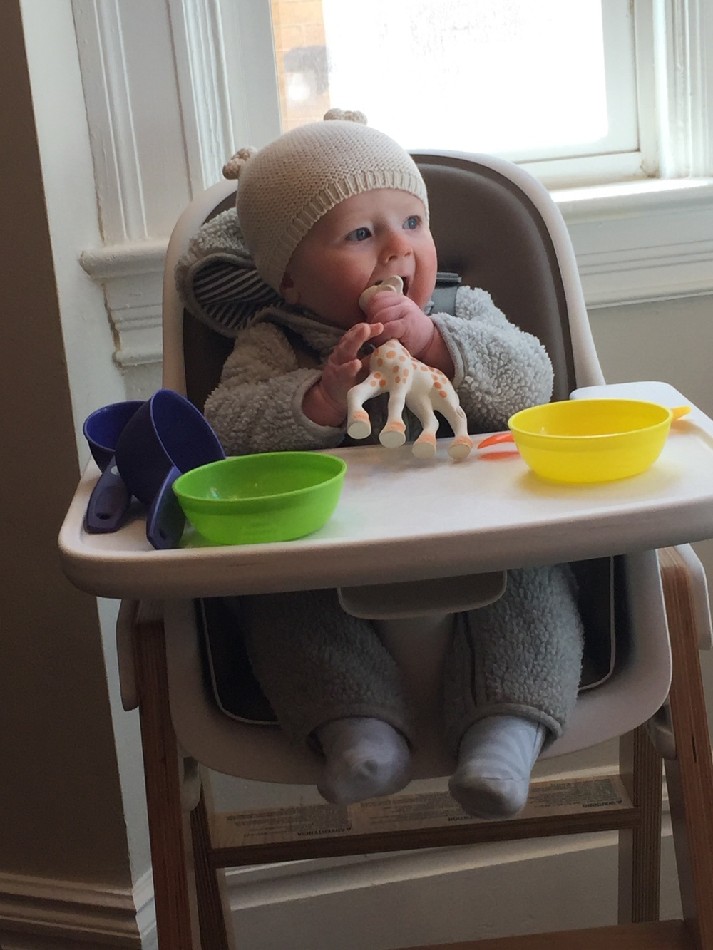 As a sidenote: out heat went out the day this was taken. He doesn't always sit in his high chair in full winter attire.