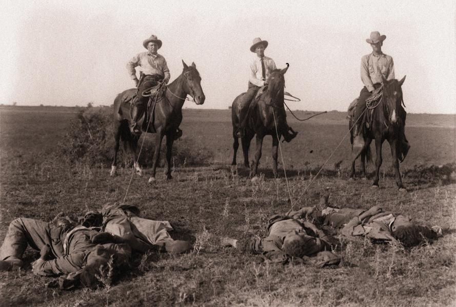 Texas Rangers with killed Mexican raiders.