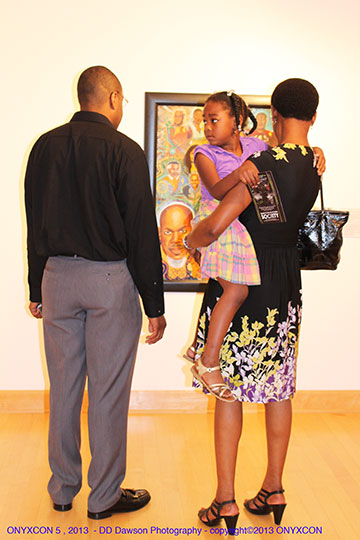 Family enjoying the 2013 ONYXCON Official Art exhibition.