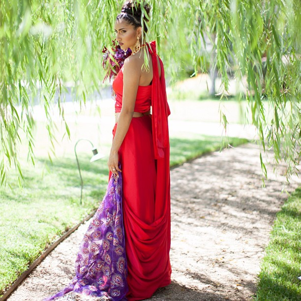 Our favorite shot of our super simple #bridal #silk #sari yes that's a big red bow hanging down the back of her neck #lambsbloodapparel #indianfashion