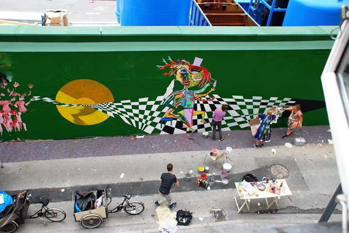 Local artists painting a mural on the construction barriers. Photo Credit: Byens Hegn