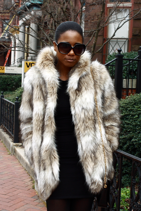 VCU (Virginia Commonwealth University) student wears a silver white fur coat and large dark round sunglasses on a chilly school day.