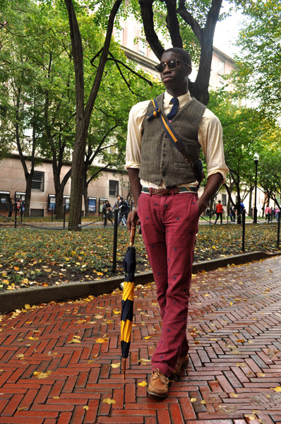 Bedecked in Rugby RL with their signature umbrella, critter pants, tweed vest and a pair of Wayfarers, Ola is your modern preppy guy, taking a walk through a rainy NYC!